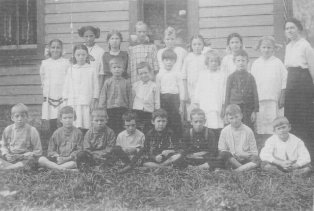 In this picture you have three boys with the last name of Moore. However no first names are given for them. Most everyone else has a full name. This is a school class in Costello, Pennsylvania.